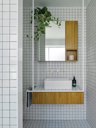 New bathrooms feature finely detailed custom vanity units made from timber and steel.
