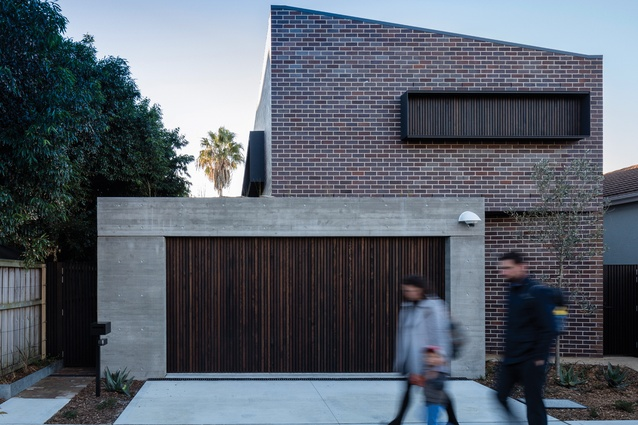 Cricket Pitch House features a diagonal roof ridge and four facades that each respond to their orientation.