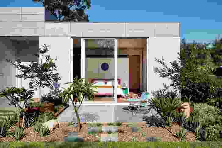 The main bedroom extends onto a garden at the rear. Artwork: Yves Klein. Styling: Alicia Sciberras.