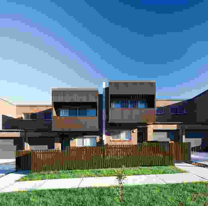 The Seven Hills row housing responds to the slope of the street.