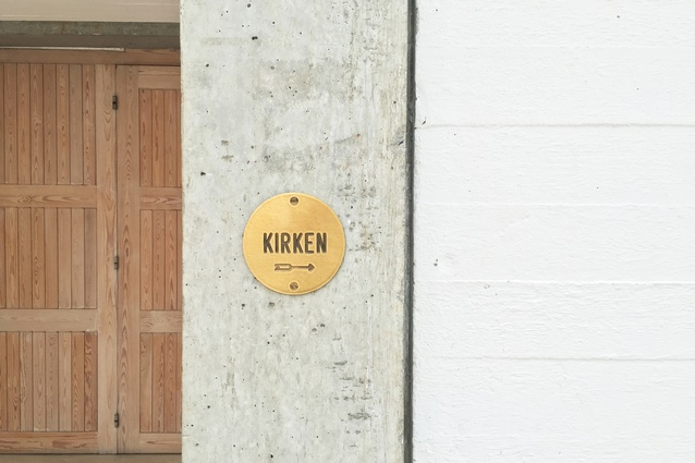 Signage is in the form of small, round brass plates.
