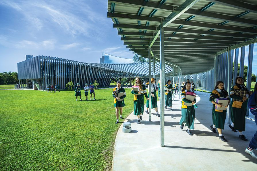 The new science building at Trinity Anglican School is a concrete and single masonry block structure wrapped in a sunscreen of prefabricated steel channels.