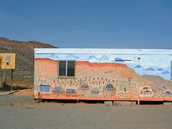 Mural painted by residents of the Larapinta Valley Town Camp community on the side of the Larapinta Valley Learning Centre.  Photograph Larissa Johnson.