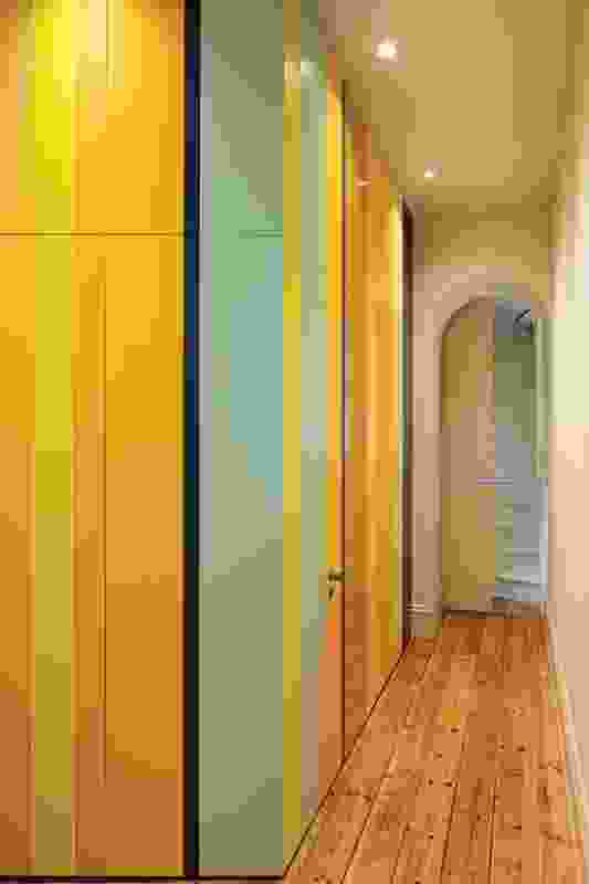 Wet areas are concealed behind colourful sliding doors.