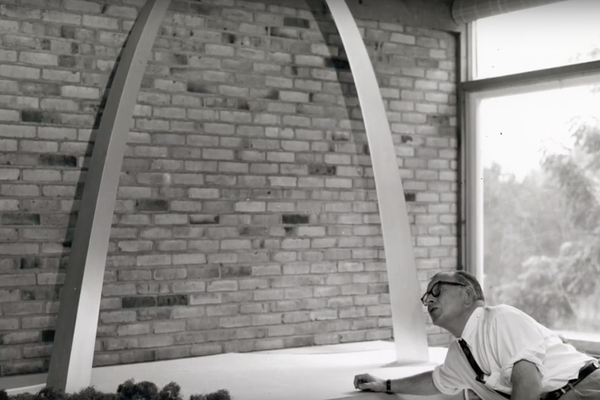 Architect Eero Saarinen with a model of the St. Louis Gateway Arch.