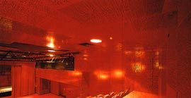 The rich red interior of the theatre, clad in braille-patterned plywood acoustic panels. Images: John Gollings