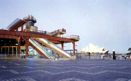 The passenger terminal shortly after its 1988 redevelopment, showing the orange skeletal frame and the striking outdoor escalators at its southern end. Image: John Gollings.