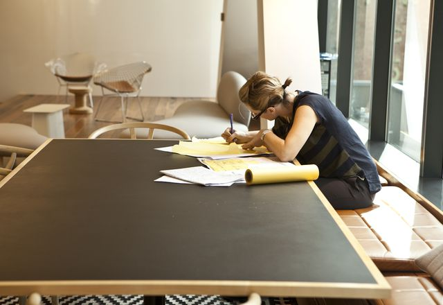 A female architect at work in BVN studio.