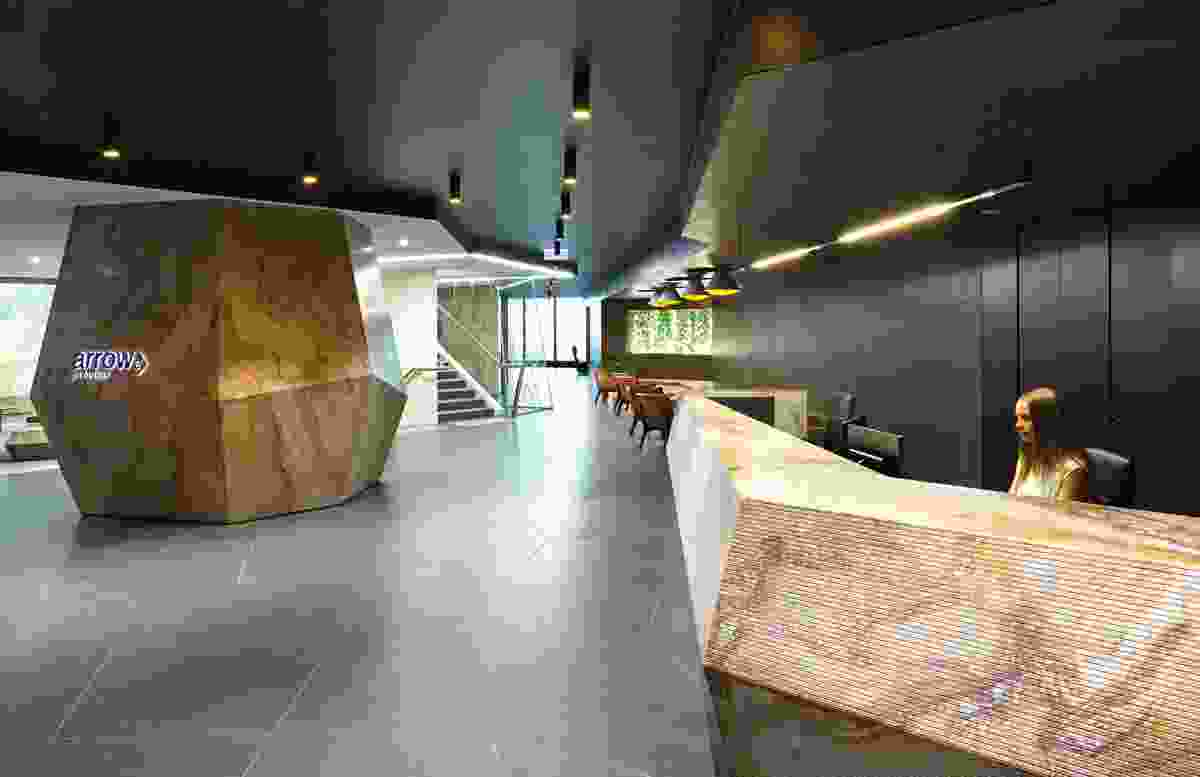 The reception area features an earthy palette of charcoal and rust colours.