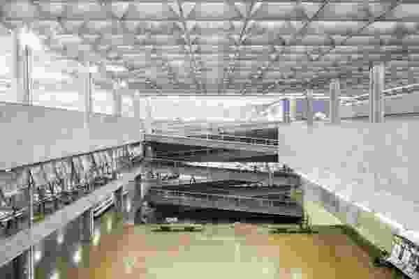FAU-USP features a vast atrium illuminated from above through a sublime textile of interlocking concrete elements.
