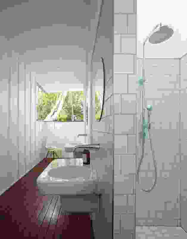 The new bathroom is accessed via a covered verandah that joins the toilet and shower room.