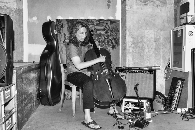 Seattle cellist Lori Goldston, playing at the Seidler Penthouse.