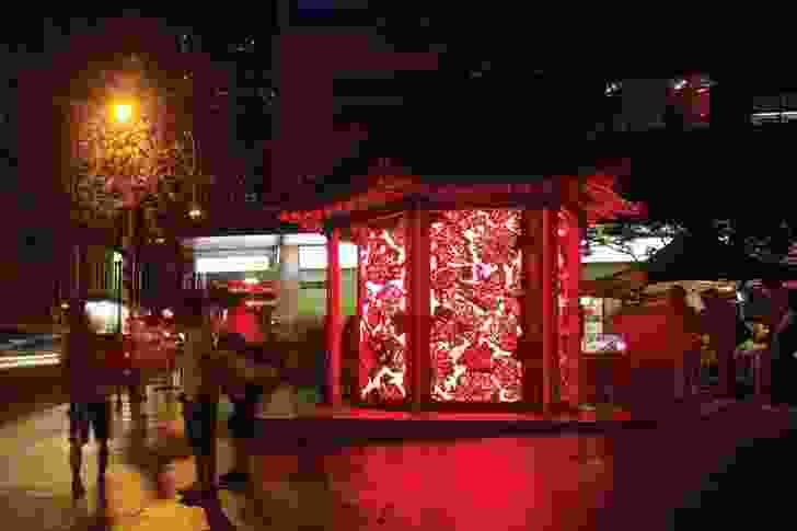 The lantern adds an atmospheric presence to the pedestrian mall.