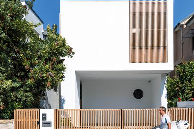Screens of rosewood timber, left to grey with age in Bondi's coastal conditions, give natural colour to the home's exterior.