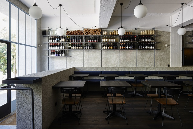 Bespoke shelving was made from painted steel sections.