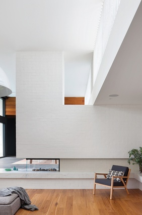 The double-height living space of the Stepping House is slowly revealed through a careful choreography of arrival and movement.
