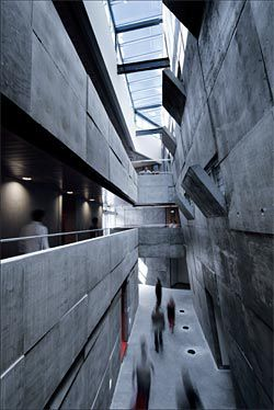 Looking along the length of the atrium, with its startling concrete interior.