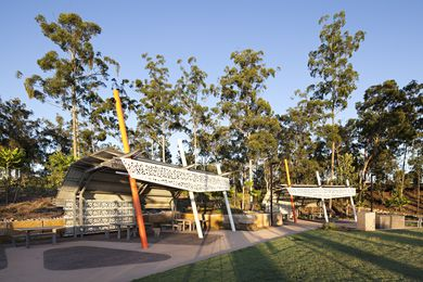 Picnic structures adjacent community entertainment precinct.