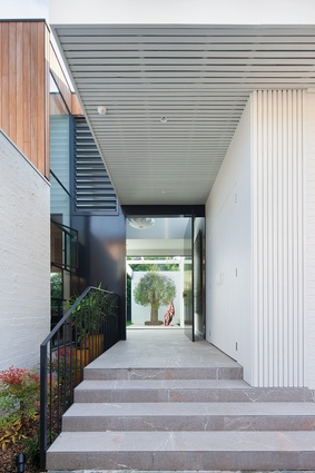 Entry to Kate's House is from the side, a common Bower planning technique that places living spaces at the rear and bedrooms at the front.