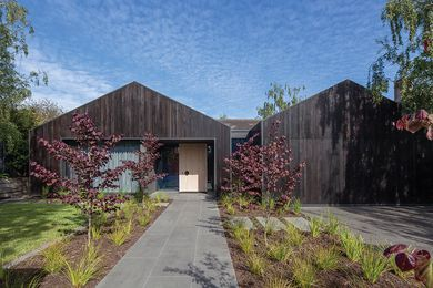 A striking facade of charcoal-stained timber radically alters the house's appearance in the streetscape.