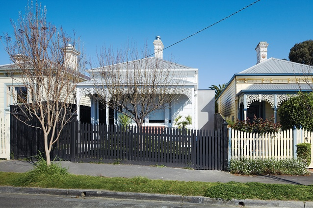 The restored front elevation of the 1890s weatherboard cottage.