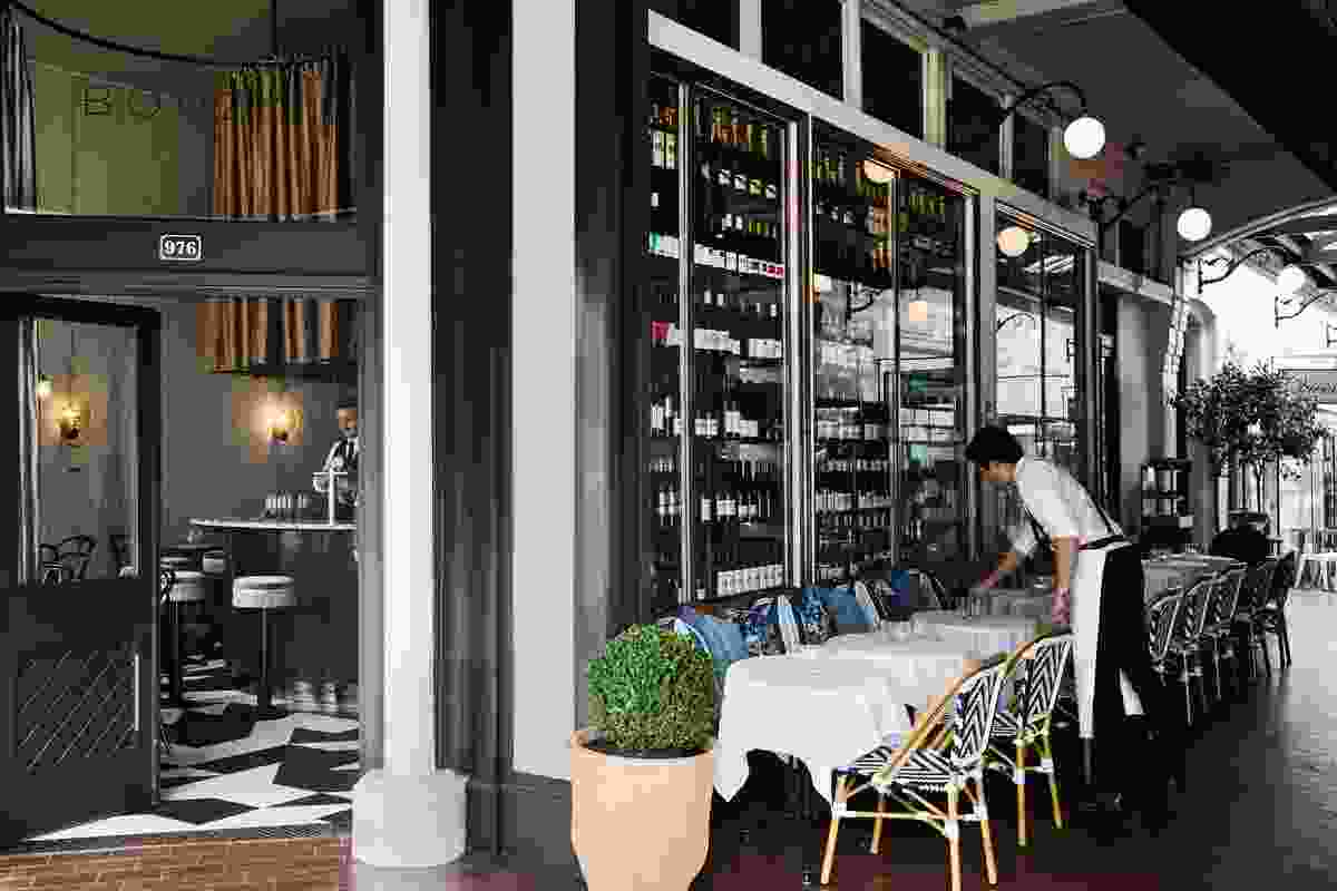 The building's over-scaled copper-framed windows became the perfect niche for wine display.