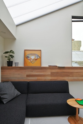 With the front section of the roof pitched at an angle to satisfy setback requirements, the space feels like a loft apartment. Artwork: Liesl Pfeffer.