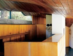 The kitchen, with its rising curving ceiling.